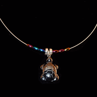 Hematite turtle on a guitar string